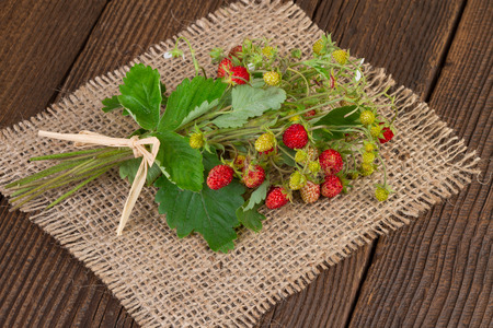 wild strawberries on a jute background photo