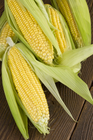 corn on the cob: corn cob on wooden background Stock Photo