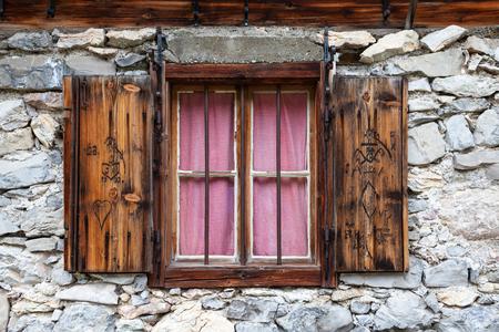 alpine hut: rustic window in a alpine hut