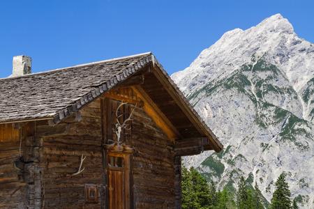 alpine hut: Rural Scene wit Mountain Range and old Alpine Hut