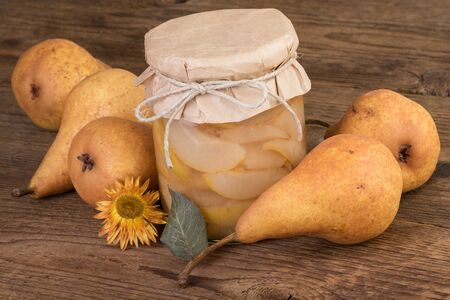 compote: jar with pears compote and ripe fruits Stock Photo