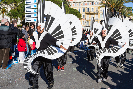 annual event: Nice, France - February 22, 2015: Participants in the carnival parade in Nice. The theme for 2015 was King of Music.The Carnival of Nice is an annual event. Editorial