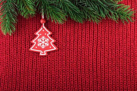 Christmas Decoration on Red Knitted Background