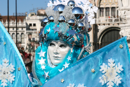 costumed: Costumed person posing at Venice Carnival, S. Marco square, Venice.