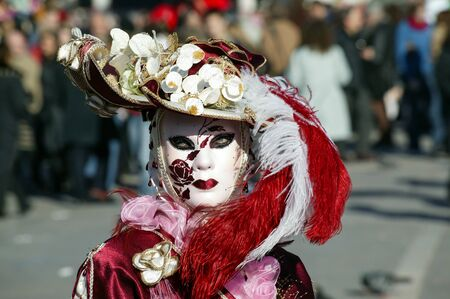 venice: Costumed person Venetian mask during Venice Carnival Stock Photo