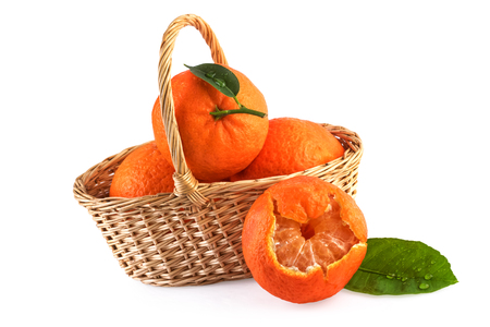 fruits in a basket: Tangerine Fruits  Basket Isolated on White Stock Photo