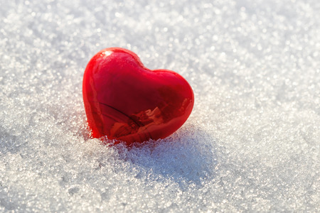 longing: red heart on ice wet snow, selective focus, outdoors image