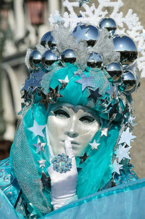 Mask in beautiful costume at Carnival in Venice, Italy