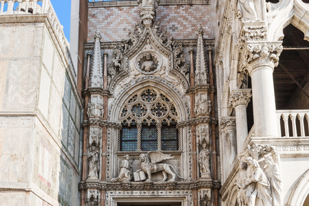 gothic architecture: VENICE, ITALY - FEBRUARY 14, 2010: The Doges Palace is a masterpiece of Gothic architecture with building elements and ornamentation from its 14th and 15th century and one of the main landmarks of the city of Venice in northern Italy.