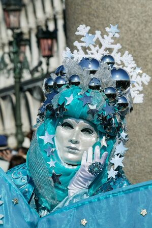 saint marks square: VENICE, ITALY- FEBRUARY 17, 2007: A woman dressed in Carnival Costume poses in Saint Marks Square on February 17, 2007 in Venice, Italy. The Carnival in Venice is annual event which ends on Shrove Tuesday.