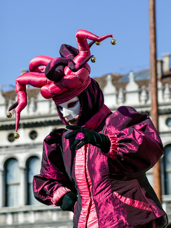 saint mark's square: VENICE, ITALY- FEBRUARY 17, 2007: Unidentified person dressed in Carnival costume posing in Saint Marks Square. The Carnival in Venice is annual event which ends on Shrove Tuesday.