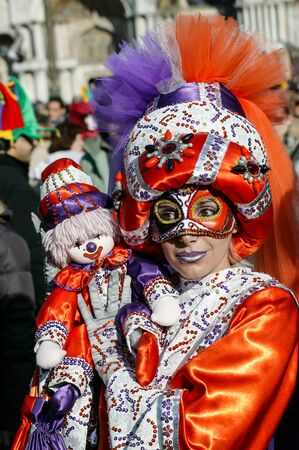saint mark's square: VENICE, ITALY- FEBRUARY 17, 2007: A woman dressed in colorful Carnival Costume poses in Saint Marks Square in Venice, Italy. The Carnival in Venice is annual event which ends on Shrove Tuesday.