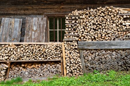 alpine hut: Firewood stacked in a alpine hut Stock Photo