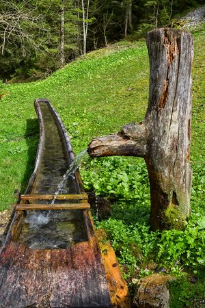 water well: Old Wooden Water Well Rustic Alpine Scenic