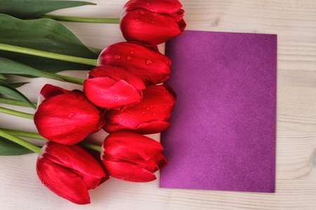 red tulips: Red tulips copy space wooden background