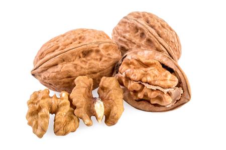 walnut: Walnuts whole and shelled. Walnuts isolated on white background. Stock Photo