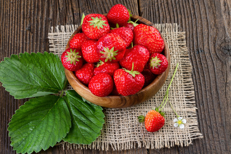 retro styled: Strawberry wooden bowl, retro styled. Stock Photo