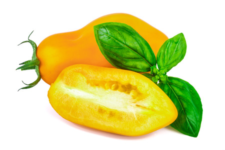 basil  leaf: yellow tomato with basil leaf Stock Photo