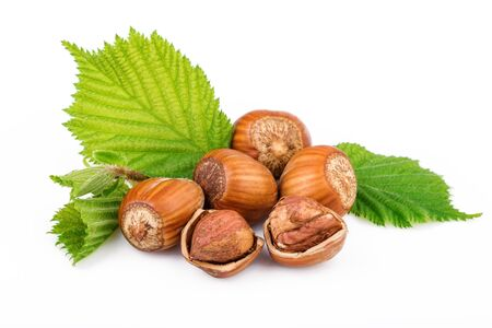 filbert nut: hazelnuts with leaves on white background