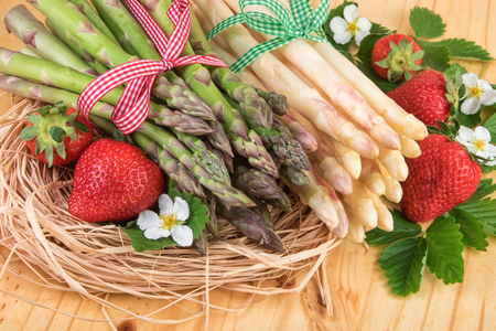 white asparagus: Green and white asparagus with ripe strawberries. Retro still life.
