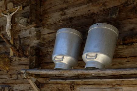 alpine hut: Milk cans in a alpine hut. Rustic farming scene.