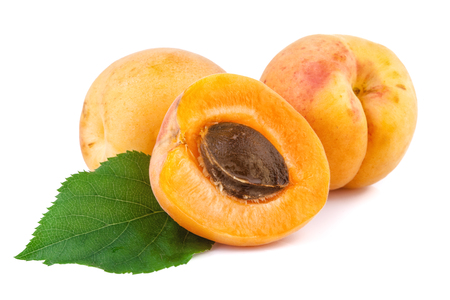 apricot kernel: Apricots closeup. Fresh apricots  isolated on white background.