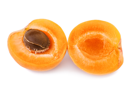 apricot kernel: Apricot with fruit kernel on white background. Closeup. Stock Photo