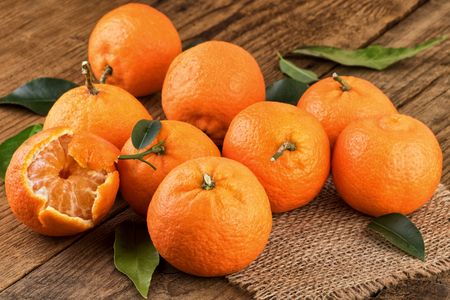 juicy: Juicy Tangerines on wooden table Stock Photo