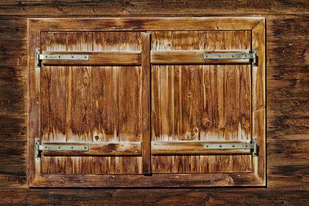 alpine hut: Vintage Window of old alpine hut. Wooden rustic background.