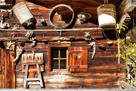 alpine hut: Rural alpine scenery. Retro decoration and architecture details of a alpine hut.