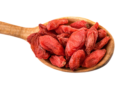 lycium: Goji berry. Dried goji berries on a wooden spoon isolated on white with clipping path