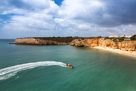 senhora: Speedboat at sea, view from above. Algarve, Portugal, Armacao de Pera