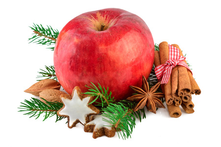 apple christmas: Red apple Christmas decorating farmhouse style rustic still life. Christmas apple with spices on white background.