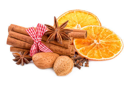 christmas spices: Christmas spices on white. Traditional christmas decoration with cinnamon anise and orange slices.