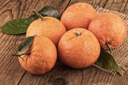 toned image: Mandarins tangerines still life toned image vintage style Stock Photo