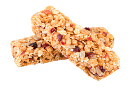 Granola bars isolated on white. Granola ingredients oats, dried cranberries, nuts, sunflower seeds, honey. Reklamní fotografie