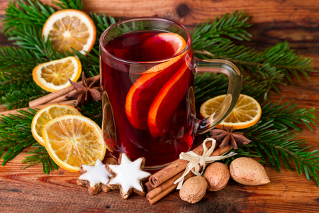 punch spice: Mulled wine with christmas decoration on wooden background