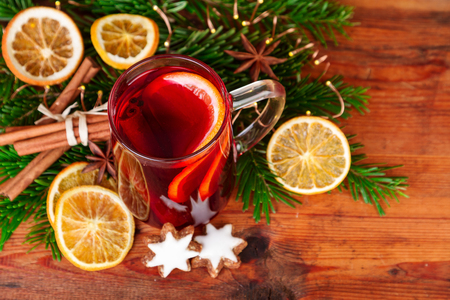 Christmas mulled wine with winter spices on dark wood. Top view.