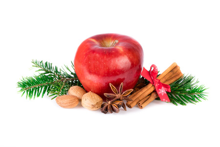 countrified: Red apple with christmas spices on white. Apple rustic still life.