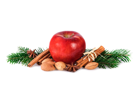 countrified: Red apple with christmas spices decoration on white