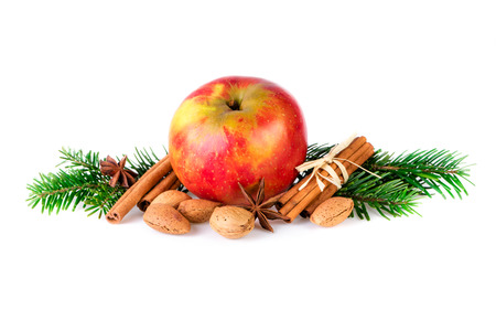 Red apple decorated with christmas spices and fir branch. Christmas apple decorating farmhouse style. Stock Photo