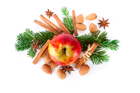 white winter: Christmas composition with red apple and winter spices on white. top view.