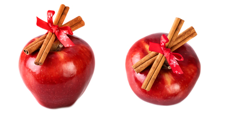 Bright red apples christmas decorated with cinnamon sticks on white background Stock Photo