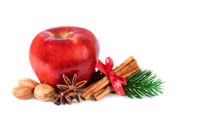 Red Apple rustic decorated with winter spices. Christmas apple isolated on white.