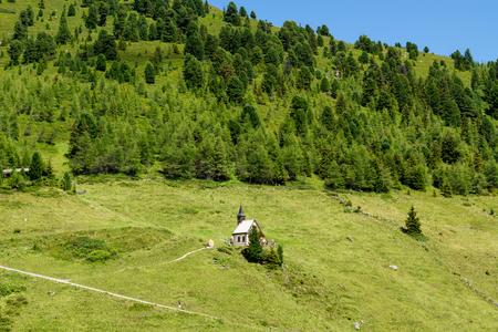 Idyllic mountain scenery with little church in the Alps. Austria, Zillertal High Road, Tirol Stock Photo