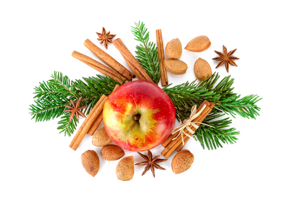 Christmas arrangement with red apple, fir branch and spices flat lay on white