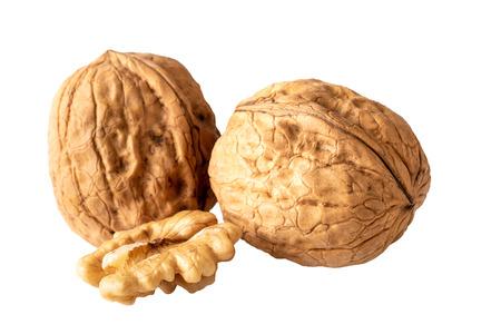 two unshelled walnuts and walnut halve isolated on white Zdjęcie Seryjne