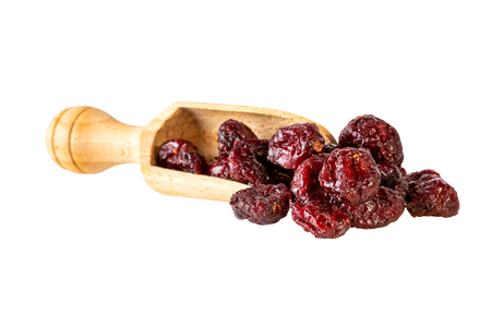 dried cranberries in scoop isolated on white. Image included clipping path