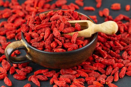 Cup with goji berries in close up.
