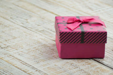 polka dotted: Pink polka dotted gift box and black on a white background. Stock Photo